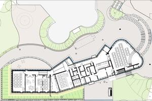 Grundriss des Erweiterungsbaus: Links befinden sich die Klassenräume, rechts der Mensabereich mit abgerundeter Fassade<br /><br />
