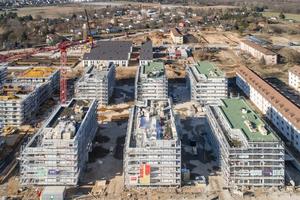 In Mannheim ließ die Wohnbaugesellschaft Instone Real Estate sechs siebengeschossige Wohnhäuser mit Flachdächern und Loggien errichten