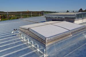 Die Dachflächen mit neuer Titanzinkdeckung in DoppelstehfalztechnikFotos: Rheinzink